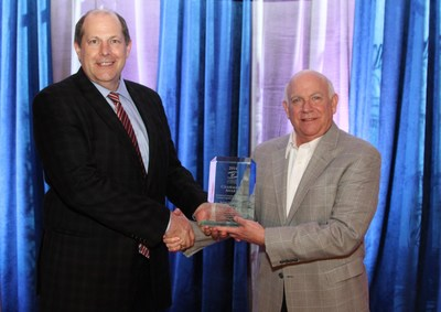 Southern Company's Chief Environmental Officer Dr. Larry S. Monroe (L) accepts Chairman's Award from Southeastern Electric Exchange Executive Director Jim Collins.