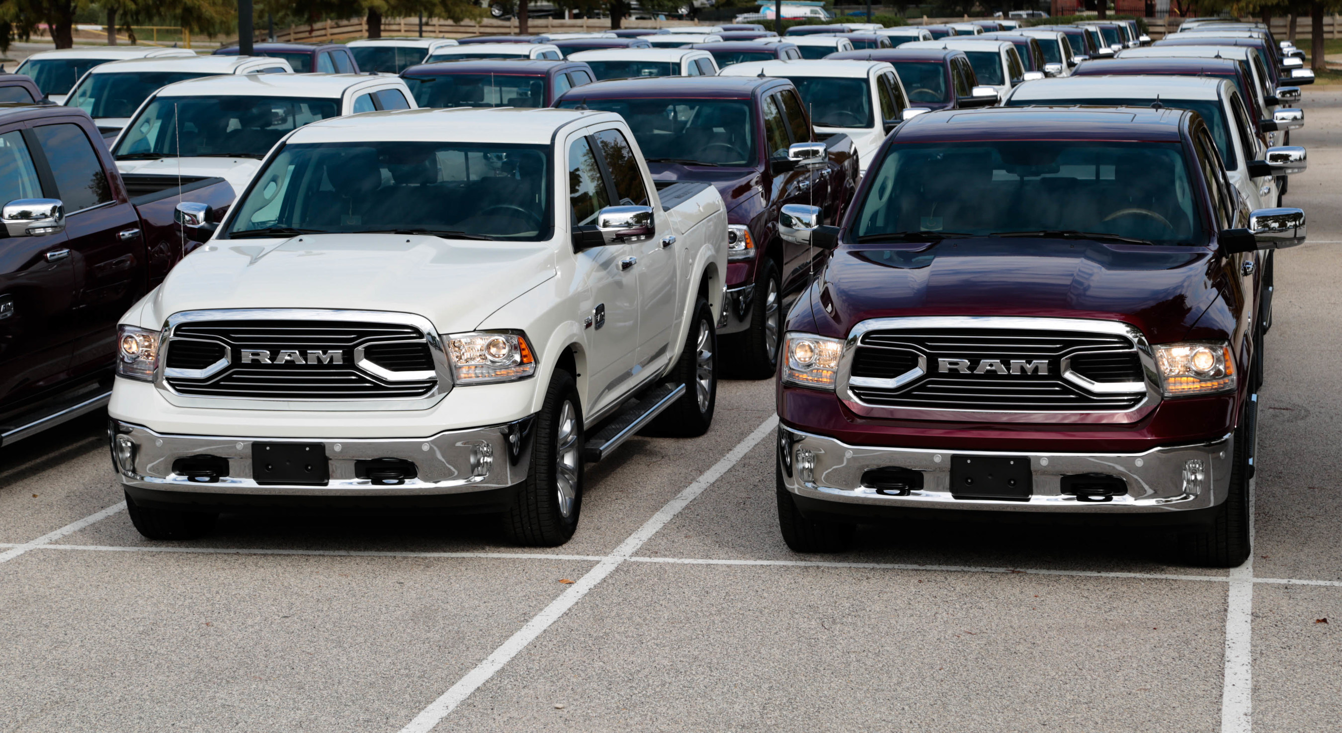 Ram hosts giant 400-truck dealer drive-away event in Dallas to celebrate Ram Laramie Longhorn's Texas Auto Writers Association Luxury Pickup Truck of Texas award.