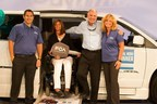 Lori Hastings, seated, along with her husband Dave, right center, are the 2016 Local Heroes Contest Winners of a Chrysler Town & Country wheelchair accessible vehicle in the caregiver category of the online contest. It is a part of the National Mobility Equipment Dealers Associations' National Mobility Awareness Month Campaign.  On left is Matt Huber and far right is Denise Berecz of FCA Us LLC.  Eldorado Mobility is providing the wheelchair conversion.