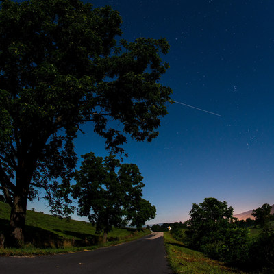 The International Space Station is seen in this 30 second exposure as it flies over Elkton, Virginia, early in the morning, Saturday, August 1, 2015. Photo Credit: (NASA/Bill Ingalls)