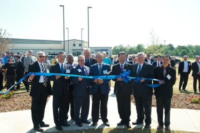 Local dignitaries and leadership from Asahi Kasei prepare to cut the ribbon at new plastics facility in Alabama