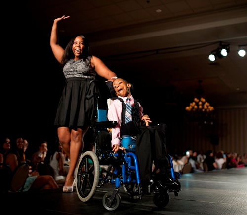Tara Hayslett models with cousin Gerald Hayslett at the Macomb-Oakland Regional Center (MORC) Kohl's Caregiver Fashion Show.  She is one of some 8,000 caregivers in the MORC system that support 5,000 people with disabilities living in homes in the ...