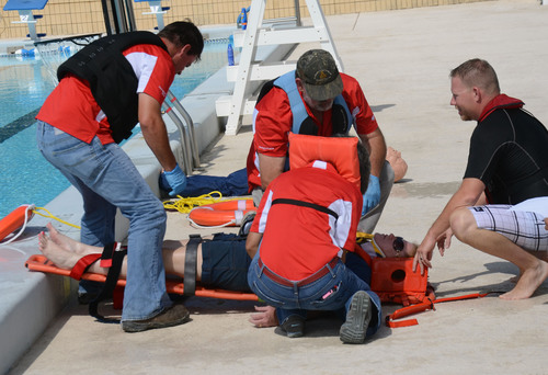 Mosaic's Hooker Prairie Mine crew simulates a water rescue and tests their victim for shock.  ...