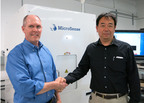 MicroSense Announces Japan Distributor for Magnetic Measurement Systems: Tom McNabb (left), President of MicroSense and Hiro Maekawa, Division Manager of Ishii Sangyo in front of MicroSense's MRAM wafer magnetic measurement system.  Ishii Sangyo will sell and service MicroSense magnetic property measurement systems in Japan.  (PRNewsFoto/MicroSense, LLC)