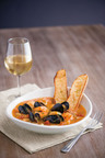Mimi's Bouillabaisse, as authentic as that found in Marseille, is a fragrant Provencal soup of mussels, shrimp and tender scallops simmered in white wine with potatoes, tomatoes and served with garlic croutons.  (PRNewsFoto/Mimi's Cafe)