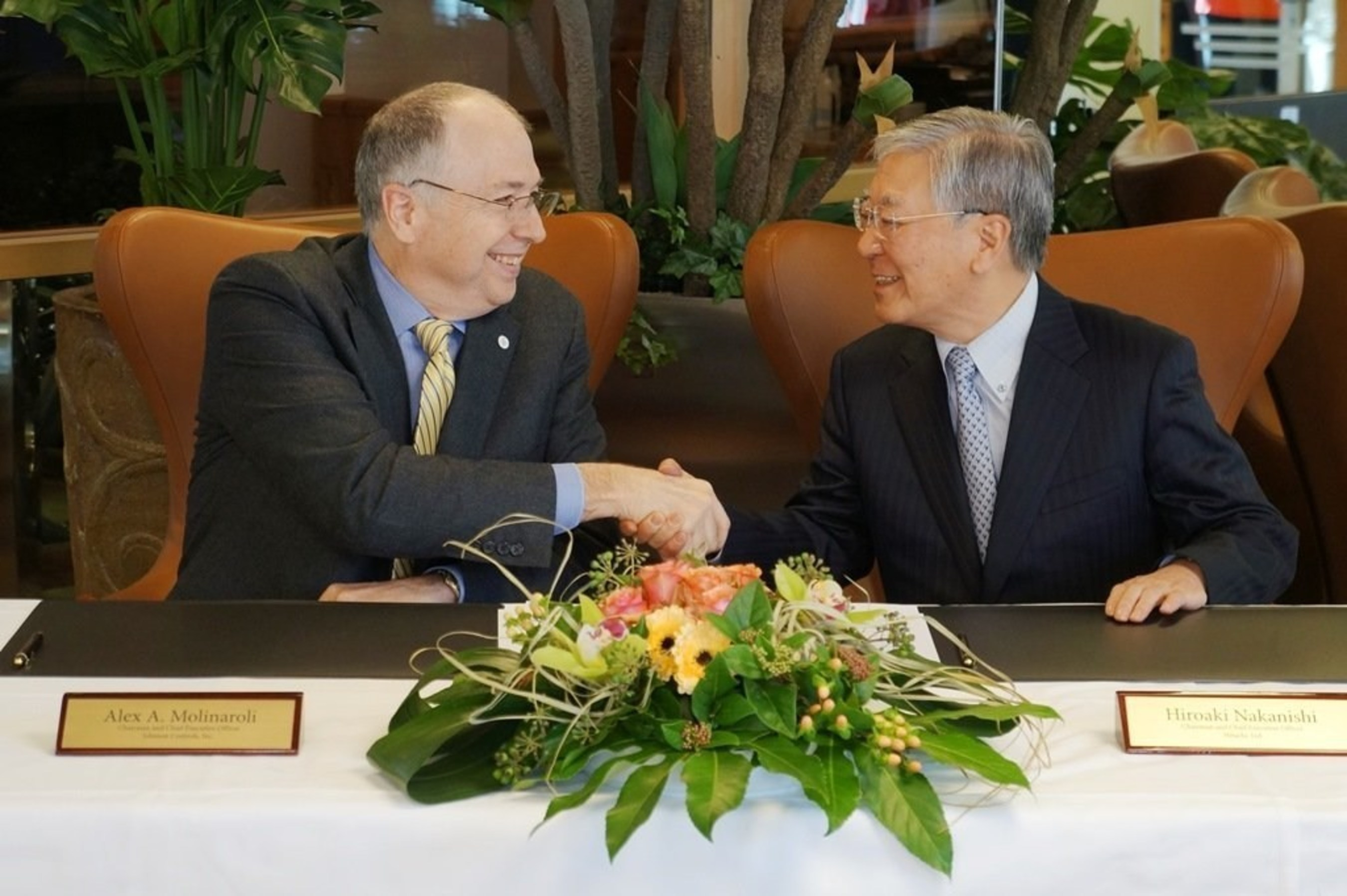 Johnson Controls CEO Alex Molinaroli and Hitachi CEO Hiroaki Nakanishi entered into a joint venture definitive agreement at the World Economic Forum in Davos, Switzerland, on Jan. 21, 2015.