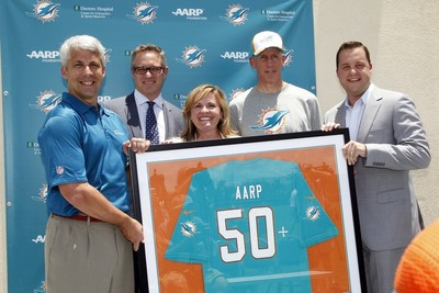 Dolphins GM Dennis Hickey, Dolphins President & CEO Tom Garfinkel, AARP President Lisa Marsh Ryerson, Dolphins coach Joe Philbin and Senior Vice President & Chief Revenue Officer Jeremy Walls. (PRNewsFoto/AARP Foundation)
