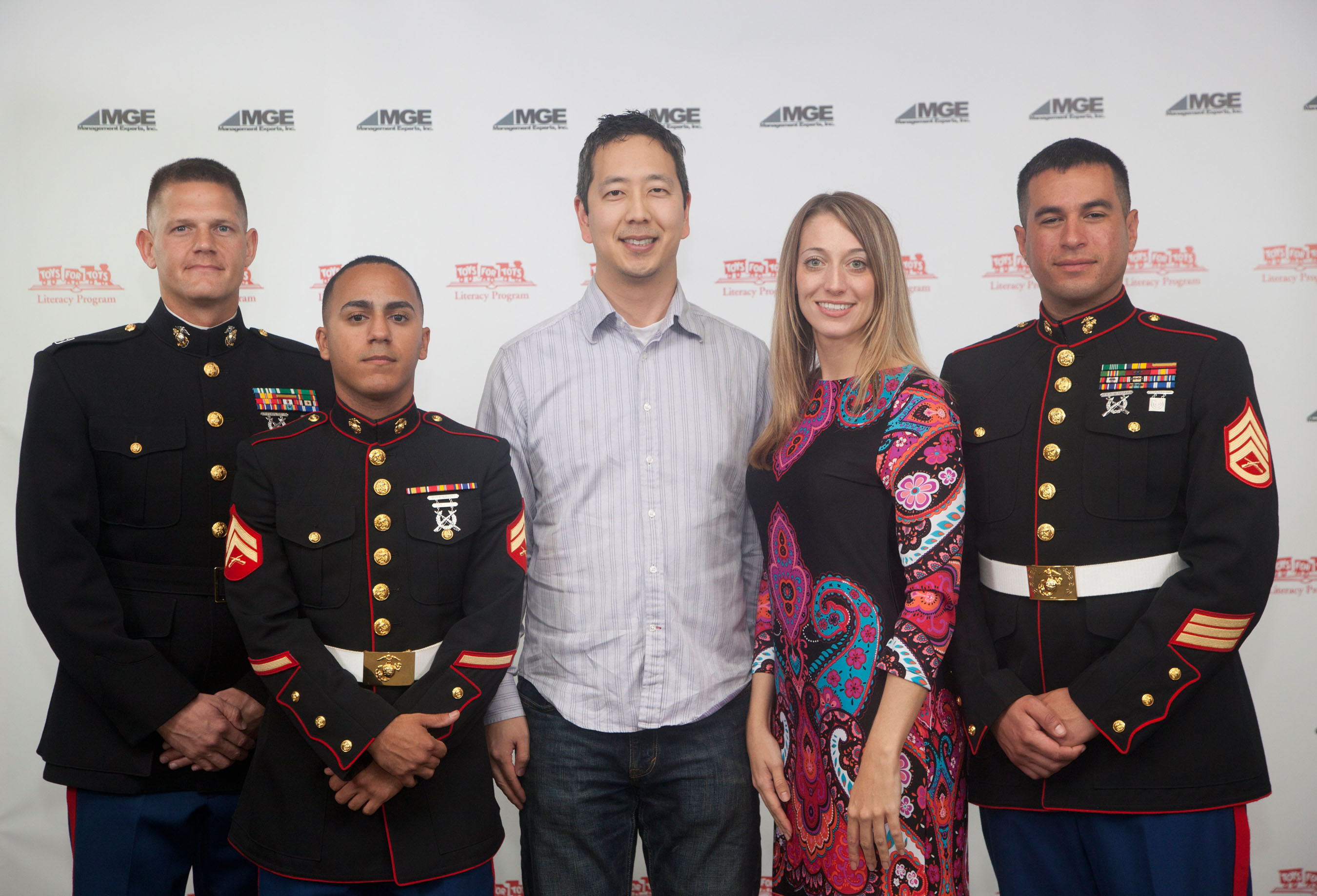 Kids & Grownups Dental Joins U.S. Marines in Fight Against Poverty.  (PRNewsFoto/Kids & Grownups Dental)