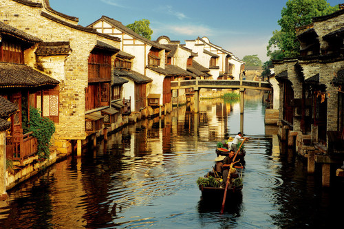 Wake up naturally on Wuzhen's water pillow, listen to the gentle sway of the sculling boat outside the window, and experience the carefree and leisurely life in this small Yangtze River Delta town. (PRNewsFoto/Wuzhen Tourism Co., Ltd.)