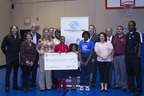 WorldVentures Foundation, the philanthropic arm of WorldVentures, presents a $10,000 check to Boys & Girls Club of Arlington, Texas. The much-needed donation will help support the chapter's developmental program and assist with renovations to its heavily-trafficked multi-purpose room, where the children play and interact with one another. The funding was raised during a recent training event for more than 6,000 WorldVentures Independent Representatives.  (PRNewsFoto/WorldVentures Foundation)