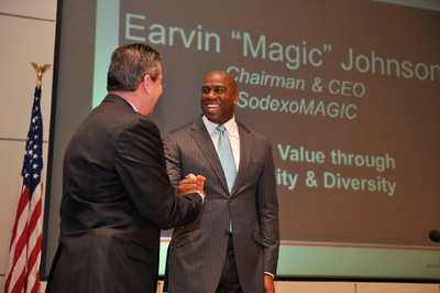 "Sodexo president and CEO, George Chavel, welcomes Earvin ""Magic"" Johnson to deliver the morning keynote for Sodexo's Diversity Business Leadership Summit at Northwestern University on Thursday, April 18, 2013.  (PRNewsFoto/Sodexo, Inc.)"