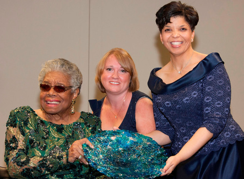 "Maya Angelou receives the Lifetime Achievement Award at ""An Evening Celebration of Women"" for her encouragement of women to be their own advocates and for helping to establish the Maya Angelou Center for Women's Health & Wellness, which opened in July at Forsyth Medical Center in Winston-Salem, N.C. On Saturday, from left to right, Dr. Angelou receives glass artwork from event organizer Kirsten Royster, Vice President of Women's Services at Forsyth, and Dr. Chere Gregory, the hospital's director of neurosciences.  ..."