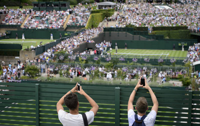 Fans taking photographs with mobile phones. (Credit: The Championships Wimbledon 2014 - The All England Lawn Tennis and Croquet Club)