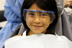 A young patient awaits her dental check up at one of WesternU College of Dental Medicine's community clinics.