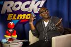 Randy Jackson with the new Let's Rock Elmo toy from Playskool in New York City.  (PRNewsFoto/Hasbro, Inc.)