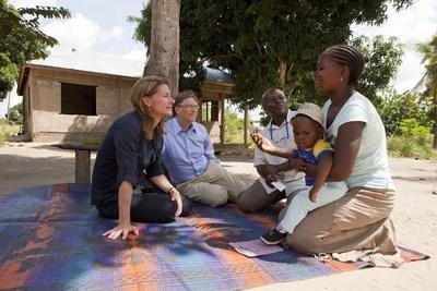 Bill and Melinda Gates meet a mother and child in Mapinga, Tanzania. (PRNewsFoto/Bill & Melinda Gates Foundation)