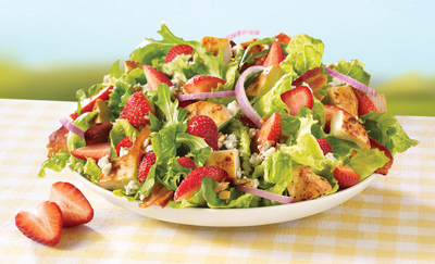 On the heels of adding two new permanent menu items to its premium salad line - the Asian Cashew Chicken Salad and BBQ Ranch Chicken Salad - Wendy's introduces the Strawberry Fields Chicken Salad. Wendy's is savoring the moment with the freshest salad ingredients summer has to offer and will use more than two million pounds of freshly harvested California strawberries, hand-picked at the peak of ripeness and hand-sliced in every restaurant. (PRNewsFoto/The Wendy's Company)