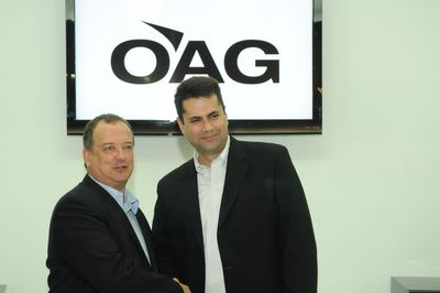 John Grant, executive vice president of OAG (left) celebrates the new agreement with Josh Marks, CEO of masFlight, at the World Route Development Forum in Abu Dhabi, UAE.