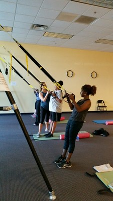 Wounded Warrior Project Alumni utilize TRX training methods during a recent Physical Health and Wellness event.