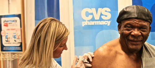 Pro Football Hall of Famer Carl Eller receives flu shot at a CVS/pharmacy in Minneapolis as part of National ...