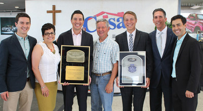 From left to right: Miles Lowenfield, Norma Conrad, Justin Lowenfield, Clay Lowenfield, Ronnie Lowenfield, Greg Wood and Luke Lowenfield. Ms. Conrad and Mr. Wood are Ford Representatives presenting the President's Award and Top 100 Dealers Award to the Lowenfield Family.