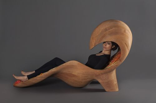 Professor Neri Oxman reclining in her Gemini acoustic chaise featuring traditional and Stratasys additive manufacturing techniques