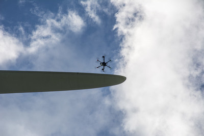 A SkySpecs' autonomous drone inspects wind turbine blades safely, efficiently and quickly.