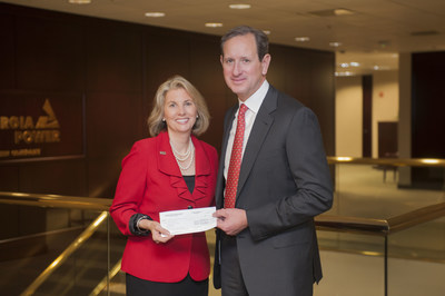 Georgia Power Chairman, President & CEO Paul Bowers presents a check from The Georgia Power Foundation to GPB President & CEO Teya Ryan in support of GPB's new chemistry and physics video series.