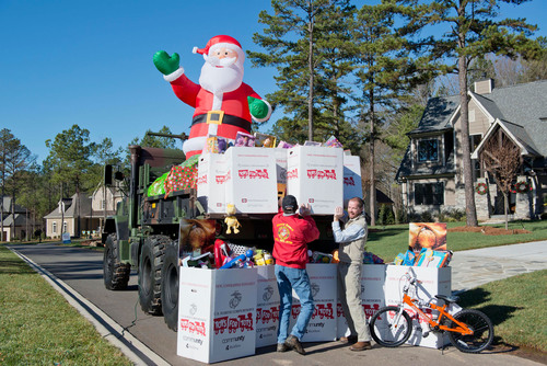 L-R: David Wyatt, a retired U.S. Marine Corps Lance Corporal, for the Marines Toys for Tots Foundation and Matt Ewers of Grandfather Homes gathered the donated toys at Cheval. (PRNewsFoto/Cheval) (PRNewsFoto/CHEVAL)