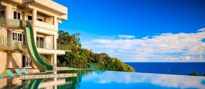 Exotic Estates - Rainbow Falls Villa - View. Villa overlooks a double waterfall that cascades down into the Pacific Ocean.