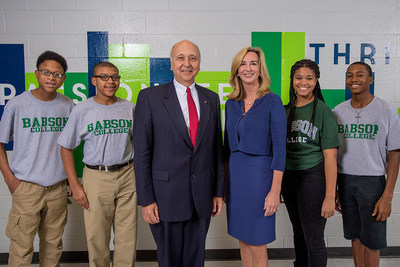 Junior Achievement President and CEO Jack Kosakowski and Babson College President Kerry Healey (both center) celebrating the new scholarship program with JA students at a recent event in Georgia.