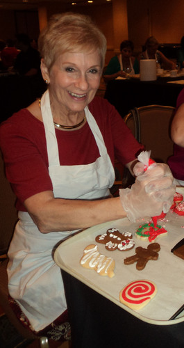 Susanna Bellafante, a member of the St. Anthony's Hospital Auxiliary, squeezes on some icing to finish decorating a few cookies during the second annual Sprinkles! cookie decorating class sponsored by the St. Anthony's Hospital Foundation.  (PRNewsFoto/BayCare Health System)