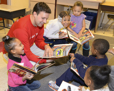 Delta Station Manager reads to children at YMCA