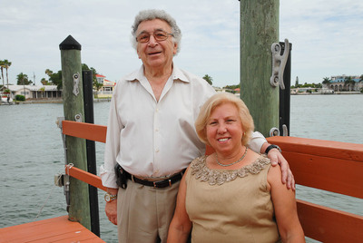 """Tampa Bay area resident Joseph Guido enjoys a moment with is wife on their pier. After completing one of BayCare's health risk assessments, Guido decided he needed to change his life for the better. """"I learned that I needed to make some changes in my diet, exercise more and reduce my stress level,"""" he said. """"The health risk assessment made me realize I needed to make changes in my life.""""  (PRNewsFoto/BayCare Health System)"""