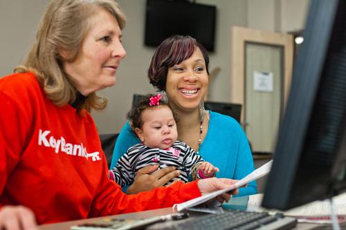 KeyBank volunteer Charlene Burley helps Scheneitha Franks of Dupont, WA during Super Refund Saturday, 2012.  (PRNewsFoto/KeyCorp)