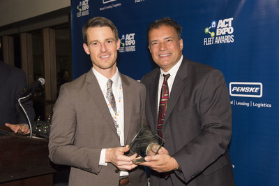Matthew Godlewski (left), President, Natural Gas Vehicles for America, presents Marty DiFiore (right), Head of FCA Transport, with the 2016 NGV Achievement Award honoring the initiative by FCA US LLC to convert 179 Class 8 tractors to compressed natural gas (CNG) rather than traditional diesel. The move gave FCA US the largest private fleet of CNG-powered heavy-duty vehicles in the state of Michigan.