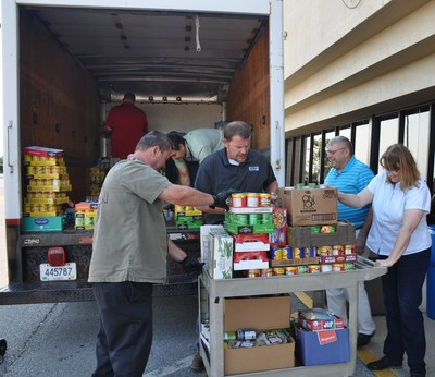 Bechtel Parsons employees load a portion of the four tons of food donated to the Richmond, KY Salvation Army for the annual food drive. Employees also donated nearly $14,000 in contributions to support the local food bank program