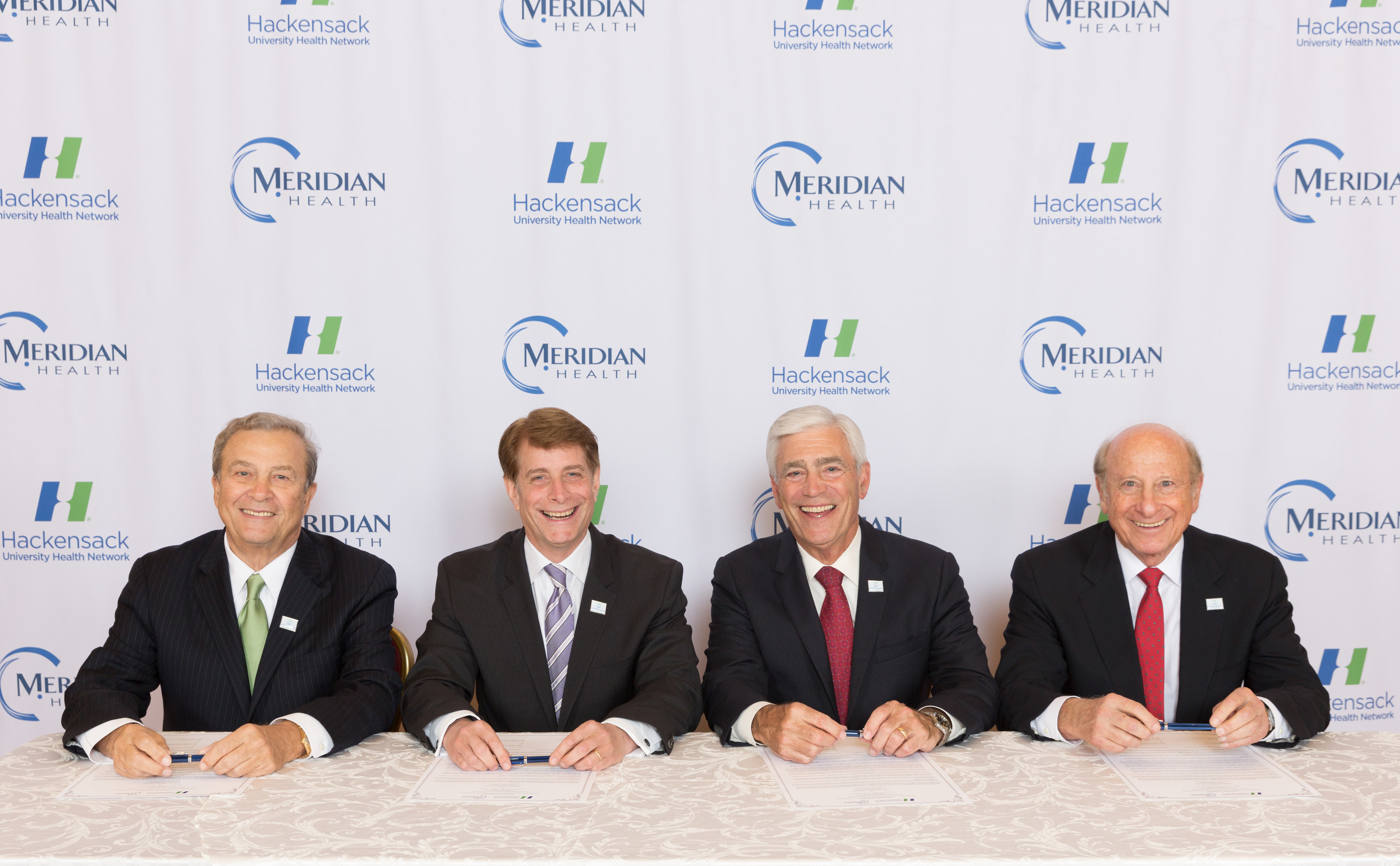 From L to R - Joseph Simunovich, chairman of Hackensack University Health Network Board of Trustees, Robert C. Garrett, FACHE, president and CEO of Hackensack University Health Network, John K. Lloyd, FACHE, president and CEO of Meridian Health, and Gordon Litwin, Esq., chairman of Meridian Health Board or Trustees