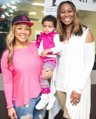 Gospel singer Erica Campbell (left) and celebrity radio host Yolanda Adams (right) helped lift the spirits of three-year-old St. Jude patient Bella (center) during the eighth annual Radio Cares for St. Jude Kids national broadcast event, which successfully raised more than $1.4 million to support the life-saving mission of St. Jude Children's Research Hospital(R). Bella received treatment for, neuroblastoma, a rare cancerous tumor, and her family shared her emotional story on The Yolanda Adams Morning Show.