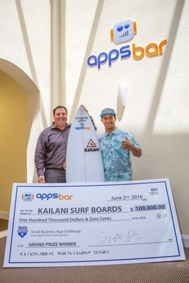 Winner Julio Nurse from Kailani Surfboards receives his $100,000 prize from Scott Hirsch, CEO of appsbar, hosts of the 'appsbar small business app challenge'- photo credit www.jakemazzone.com.