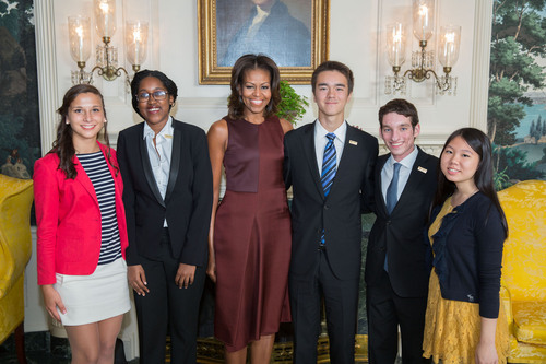 First Lady Michelle Obama with the National Student Poets award winners in the Diplomatic Reception Room of the White House, Sept. 20, 2013. (Official White House Photo by Lawrence Jackson) This official White House photograph is being made available only for publication by news organizations and/or for personal use printing by the subject(s) of the photograph. The photograph may not be manipulated in any way and may not be used in commercial or political materials, advertisements, emails, products, promotions that in any way suggests approval  ...