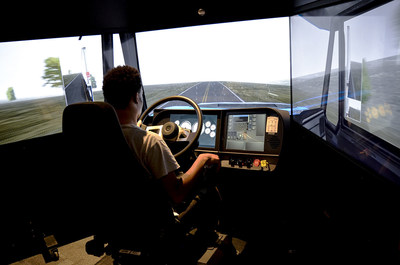 A Celadon Driving Academy student  practices his driving skill on the TransSim(TM) VS6 driving simulator.  This machine provides real world driving environments specifically designed for training commercial vehicle truck drivers.