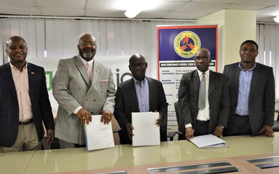 Contract signing ceremony at ECG headquarters