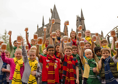 "On Wednesday, December 12, 2012, Universal Orlando Resort and its guests celebrated the five-millionth serving of Butterbeer - the incredibly popular themed beverage sold within The Wizarding World of Harry Potter. To mark the moment, Universal Orlando gave away one thousand Butterbeers to guests, including these young fans who sported ""Butterbeer mustaches"" after taking a sip. (C) 2012 Universal Orlando Resort. All rights reserved. The Wizarding World of Harry Potter(TM) Butterbeer(TM) and beverage HARRY POTTER, characters, names and related indicia are trademarks of and (C) Warner Bros. Entertainment Inc. Harry Potter Publishing Rights (C) JKR. (s12).  (PRNewsFoto/Universal Orlando Resort)"