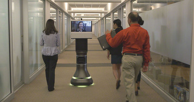 iRobot Ava 500 brings together iRobot's autonomous navigation with Cisco telepresence to deliver a new level of collaboration for office environments and other facilities.  (PRNewsFoto/iRobot Corp.)