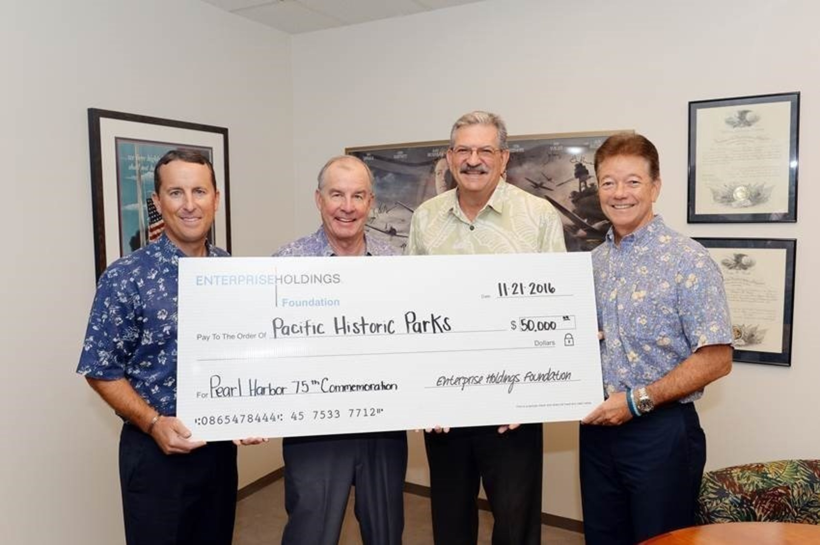 """From left to right: Vice President for Enterprise in Hawaii, Chris Sbarbaro; 75th Commemoration Committee Chair Admiral Thomas Fargo; 75th Commemoration Committee Member Tony Vericella; and Enterprise Area Sales Manager John Foy."""" photo credited to Lawrence Tabudlo, Honolulu Star-Advertiser."""