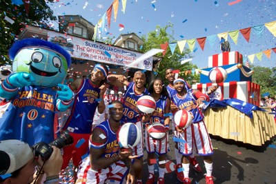 The Harlem Globetrotters celebrate their 90th Birthday with a 12-foot tall birthday cake, a marching band and performers at Silver Dollar City in Branson, Missouri.