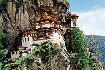 "Travelers visit the ""Tiger's Nest"" Monastery in Parom, Bhutan as part of Overseas Adventure Travel's ""India's Sikkim & Bhutan: Hidden Kingdoms of the Himalayas""--one of five new small group adventures to Asia in 2017."