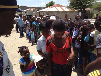 Haitians wait for medical treatment provided by Sae-A Trading and Chonnam National University Hospital.  (PRNewsFoto/Sae-A Trading Co., Ltd.)