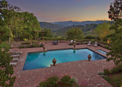 Enjoy the panoramic views among the nearly 9 acres of rolling hills, oak trees and lush landscaping. Take a stroll on the pathways and walking trails connecting all three buildings and gardens. The 14,200 sq ft main house offers 6 bedrooms, 7 full bathrooms and 3 powder rooms. A luxurious master suite with lounge area and fireplace commands a view of the sparkling pool and the rolling Orinda Hills. Orinda-only 20 miles from downtown San Francisco-was voted #2 on Forbes Magazine's 2012 'America's Friendliest Towns' list.